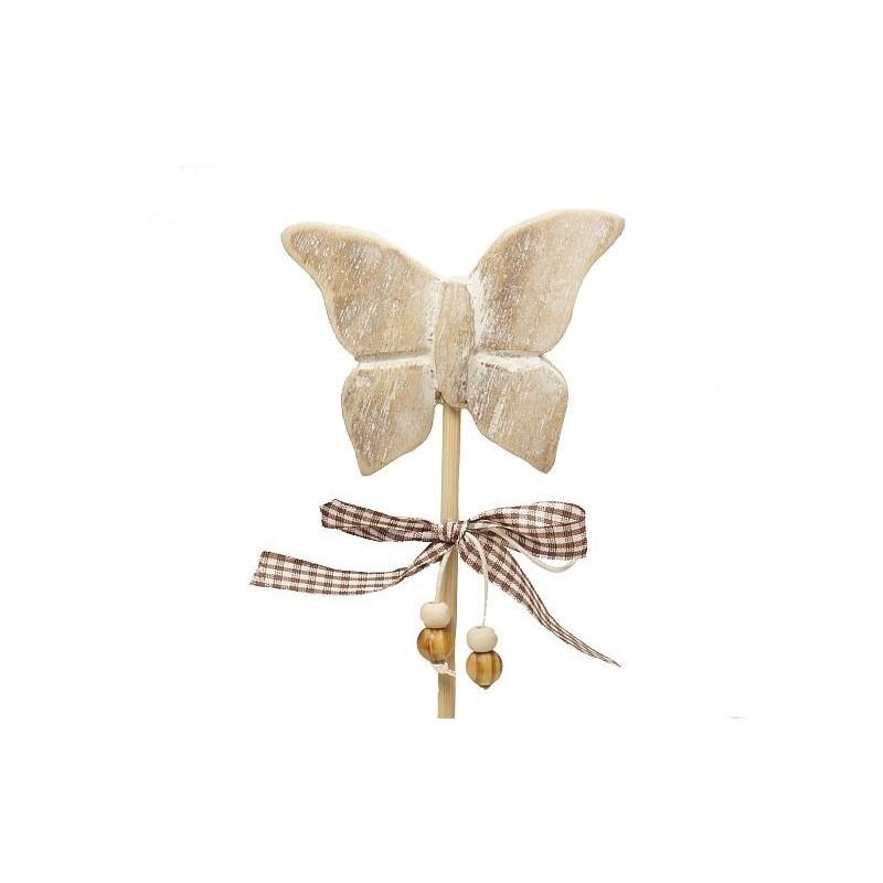 Motyl na drewnianym stojaku