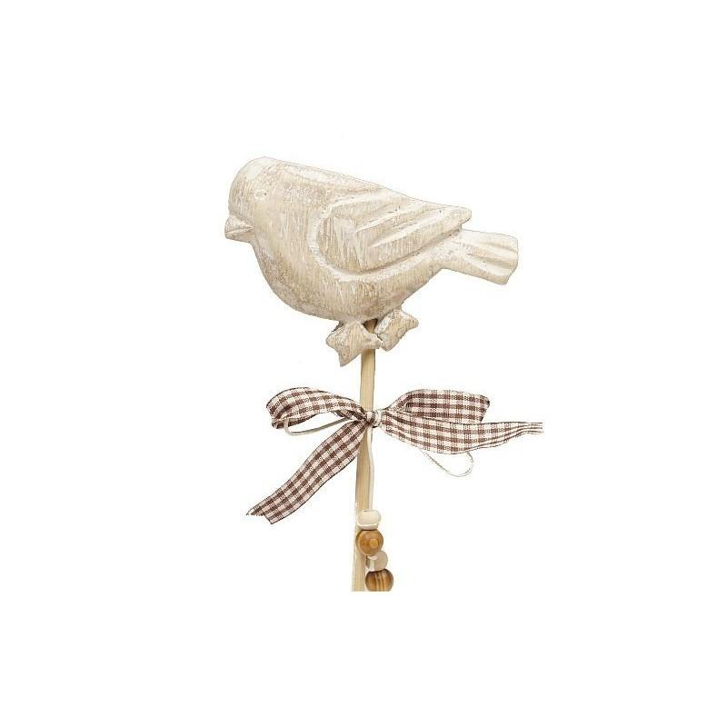 Ptak na drewnianym stojaku